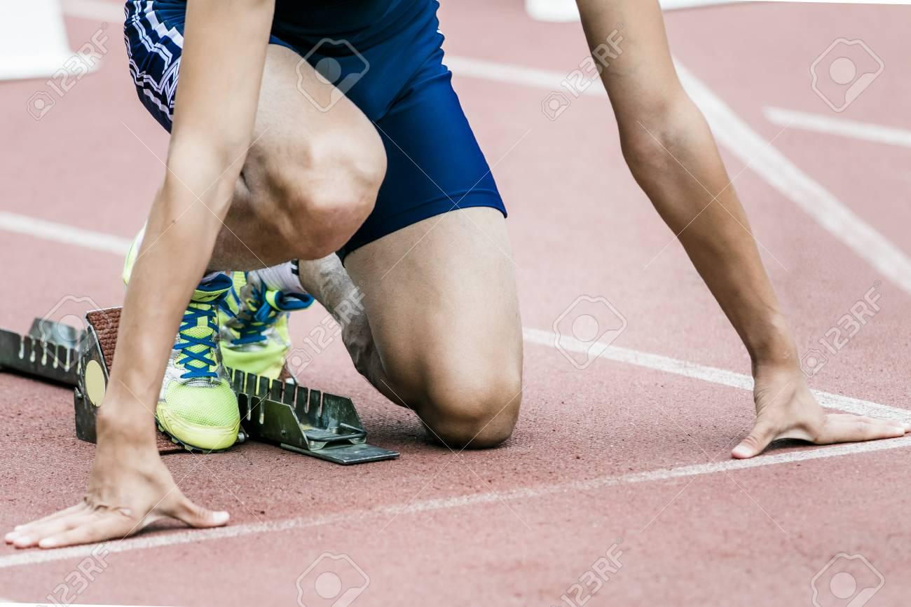 sprinter getting ready to start - 45337092