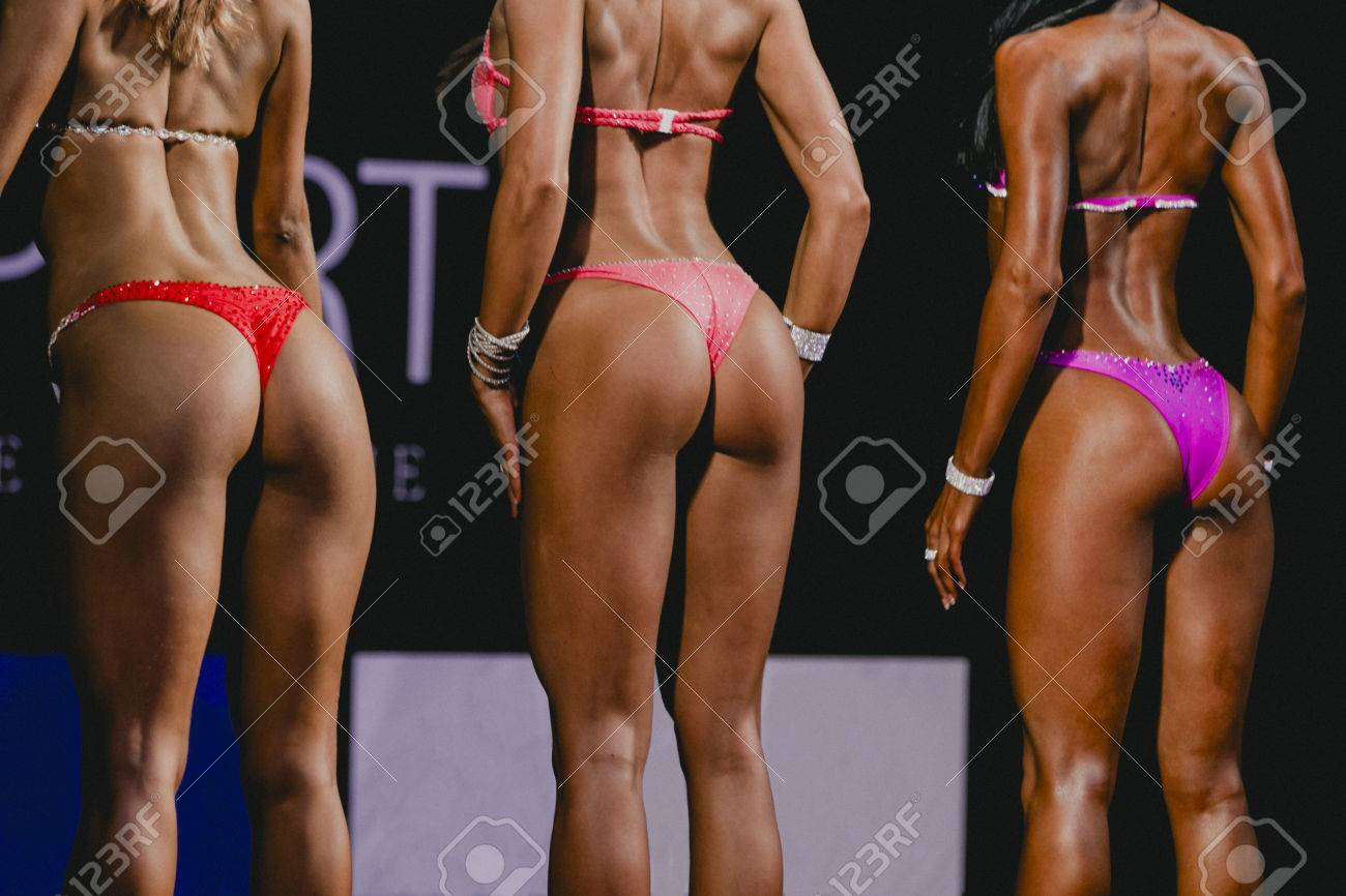 position from back girls fitness bikini. beautiful buttocks in slim swimsuit  bikini Stock Photo - 65bb681f9
