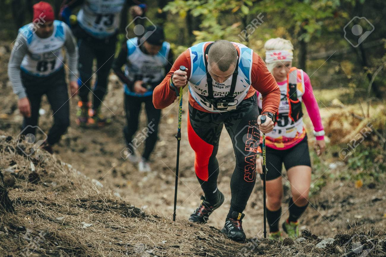 """Yalta, Russia - November 2, 2015: group of athletes running along a forest trail in mount during Mountain marathon """"Vertical kilometre AI-Petri"""" - 48185209"""