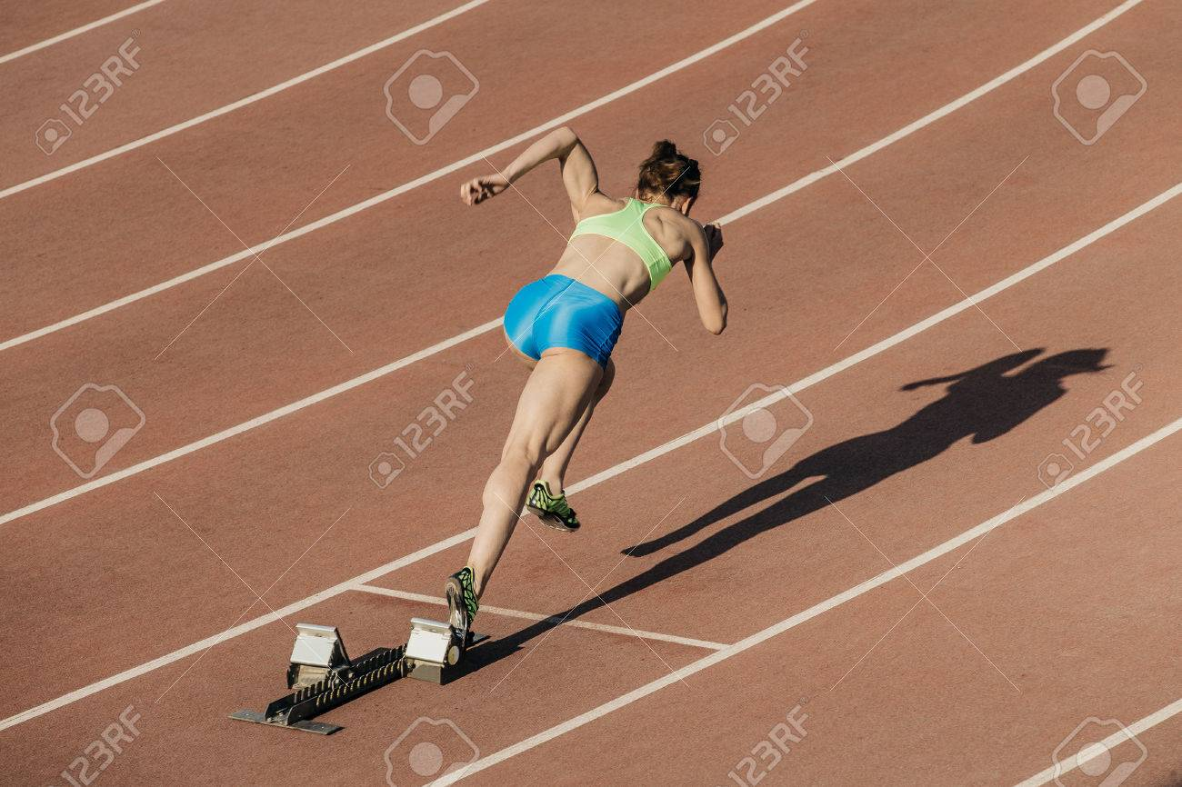 Start Women Athletes From Starting Blocks In Stadium Stock Photo