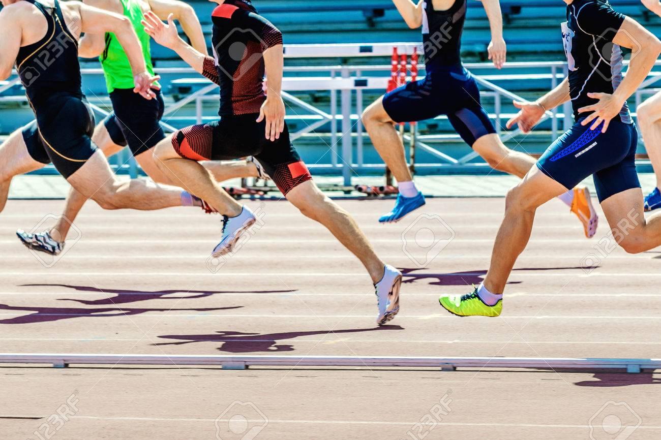 group of athletes sprinters run speed on track of stadium - 70437090