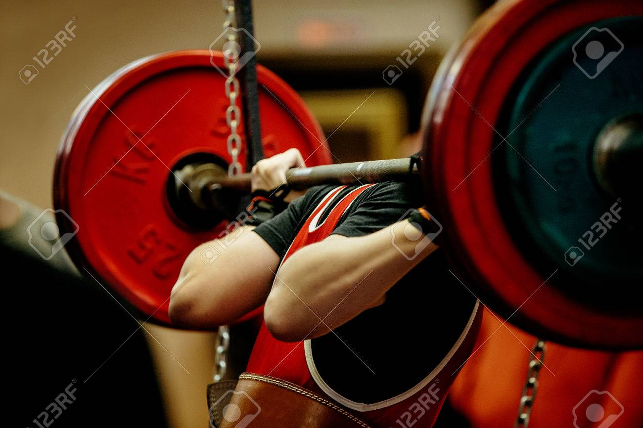 female powerlifter squat barbell for competition powerlifting - 72513209
