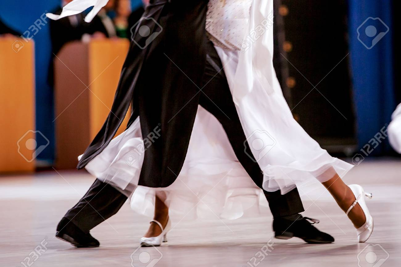 pair athletes dancers ballroom dancing. black tailcoat and white dress - 76414024
