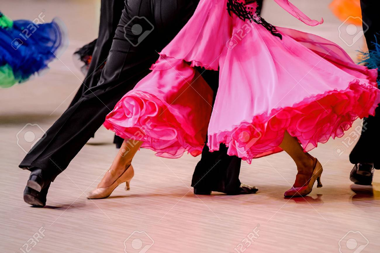 competitions in ballroom dancing. black tailcoat and pink ball gown - 76330479