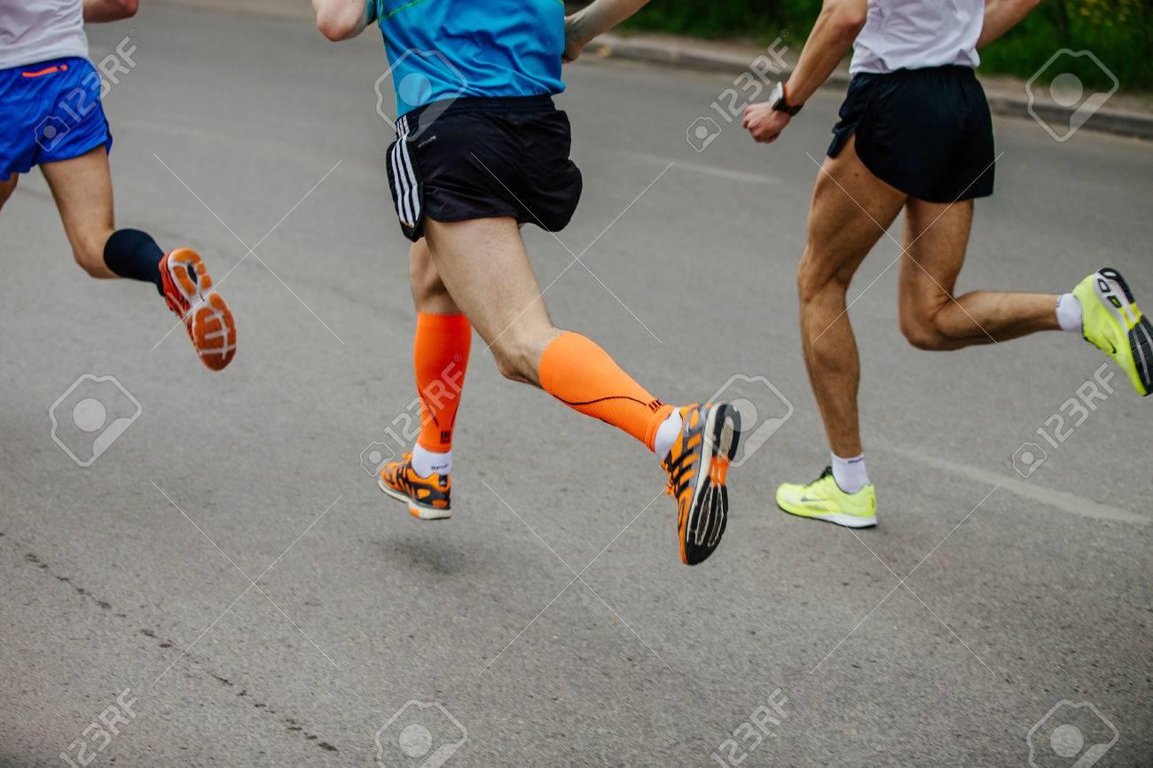 Ekaterinburg, Russia - May 21, 2017: back three men runner running on city street in City half marathon - 79290331