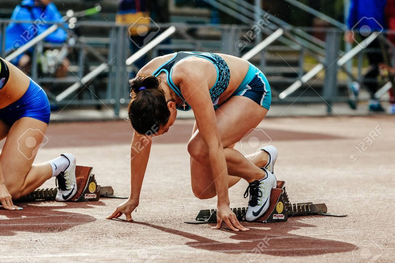 Chelyabinsk, Russia - June 4, 2017: ready start female athlete sprinter run 100 meters during UrFO Championship in athletics - 81750318