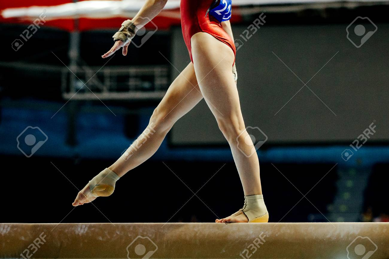balance beam girl gymnast to competition in artistic gymnastics - 85314828