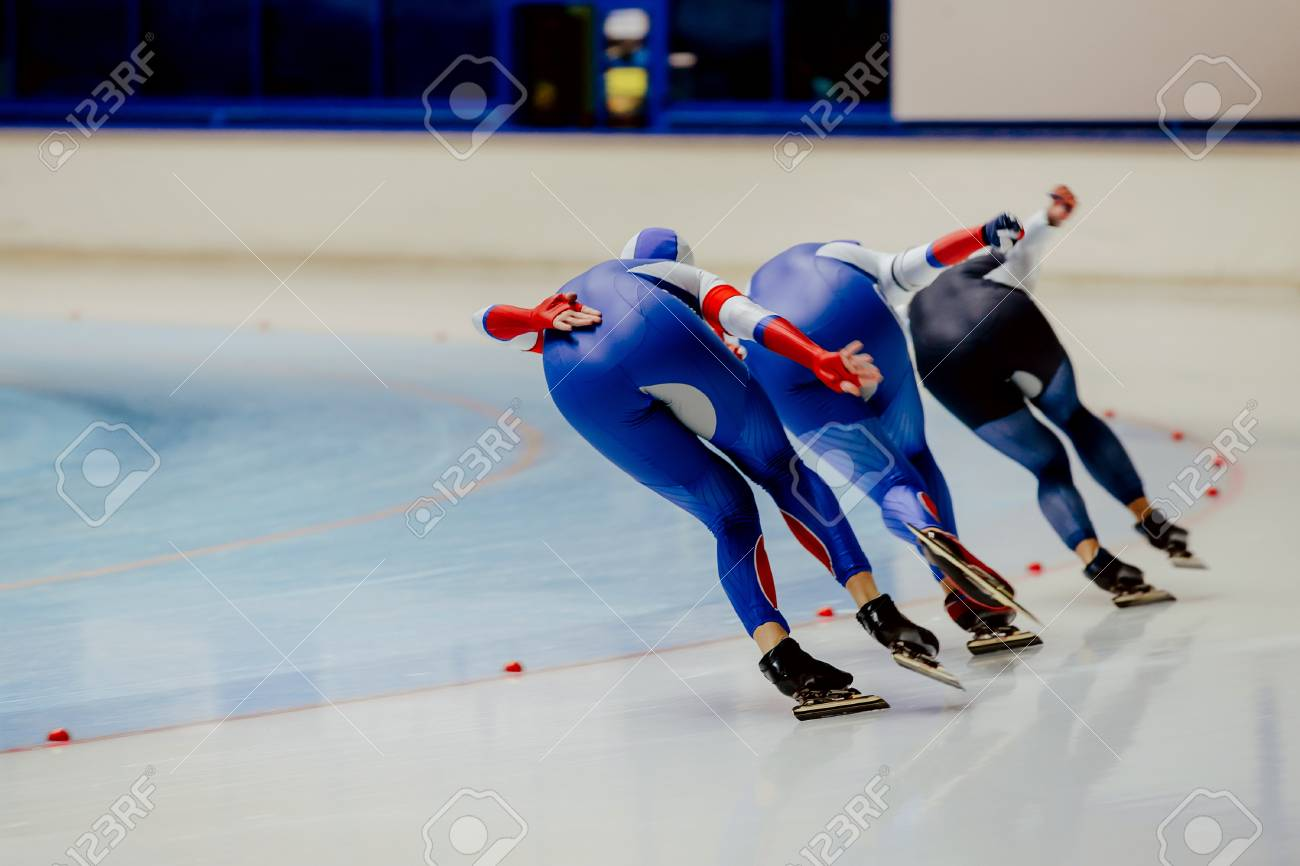 Back three women athletes speed skaters in warm-up - 90453302