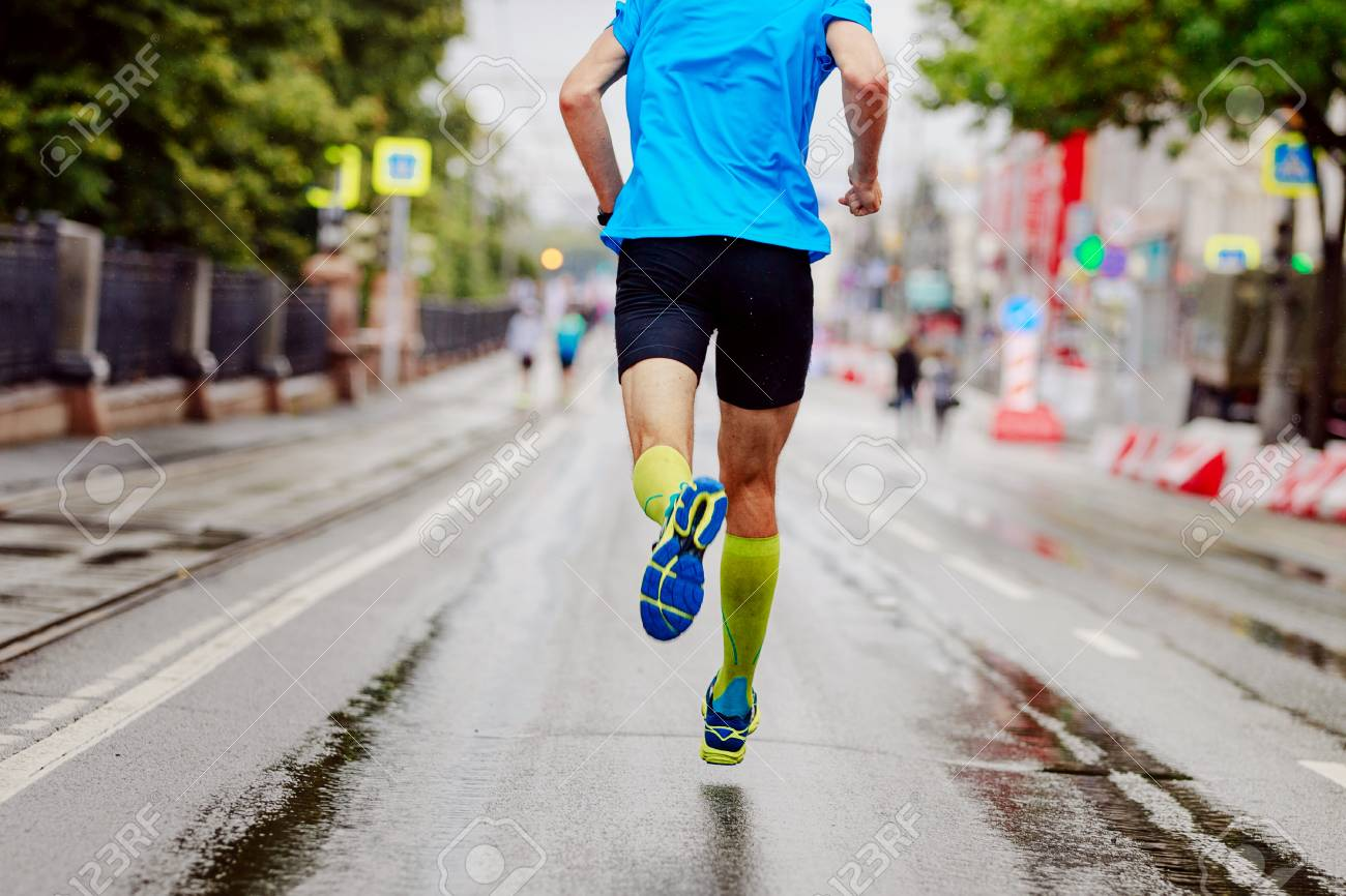 eb9757bec1 back young runner in yellow compression socks running urban marathon Stock  Photo - 97062730