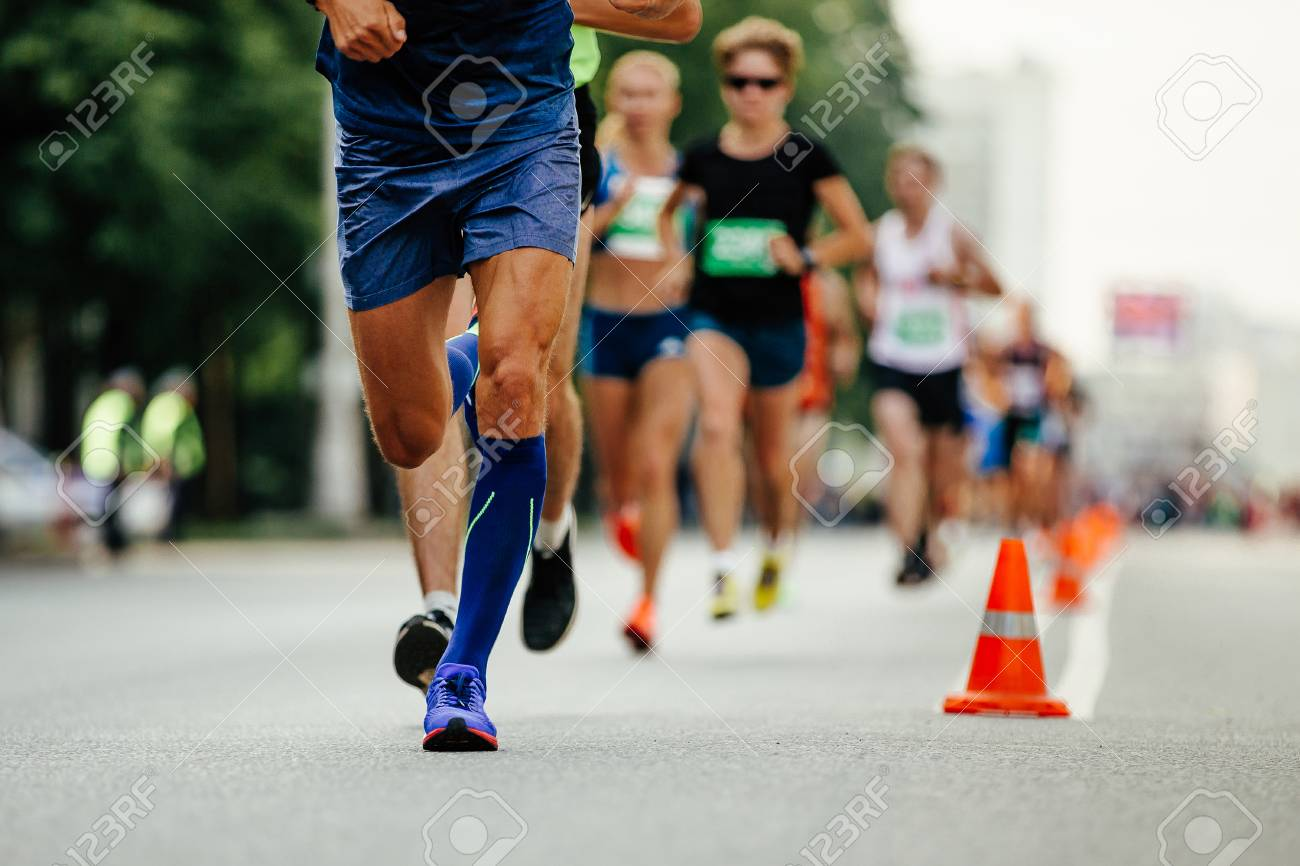 e1d0b1198e athlete runner in compression socks running ahead group of runners Stock  Photo - 107725451