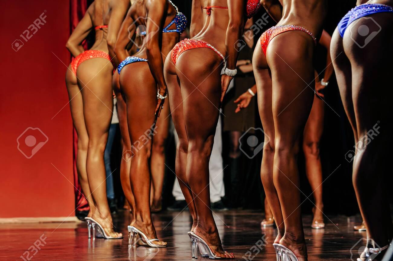 group female fitness model posing her and slender legs - 136484634