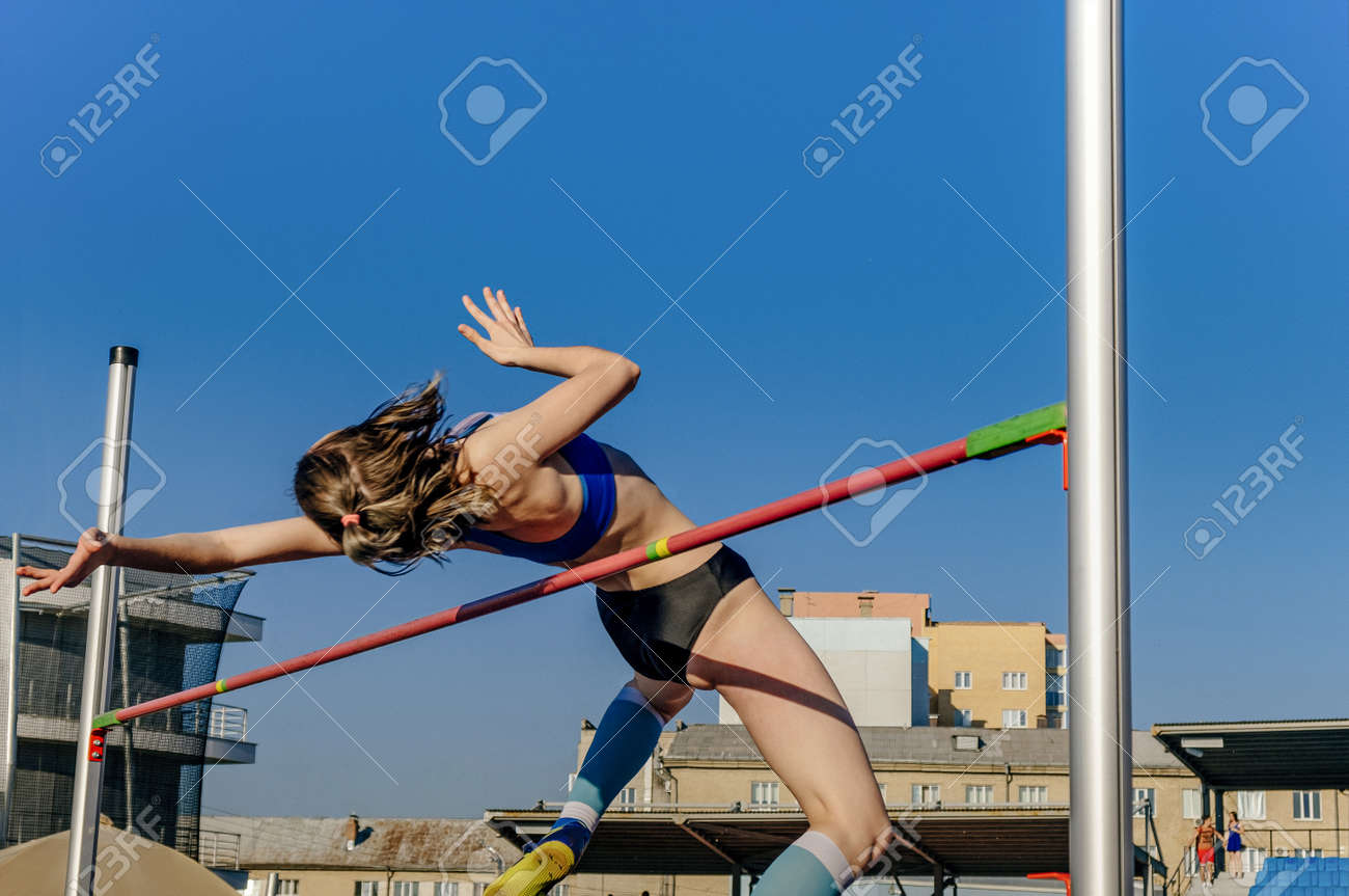 female athlete high jump at athletics competition - 171961398