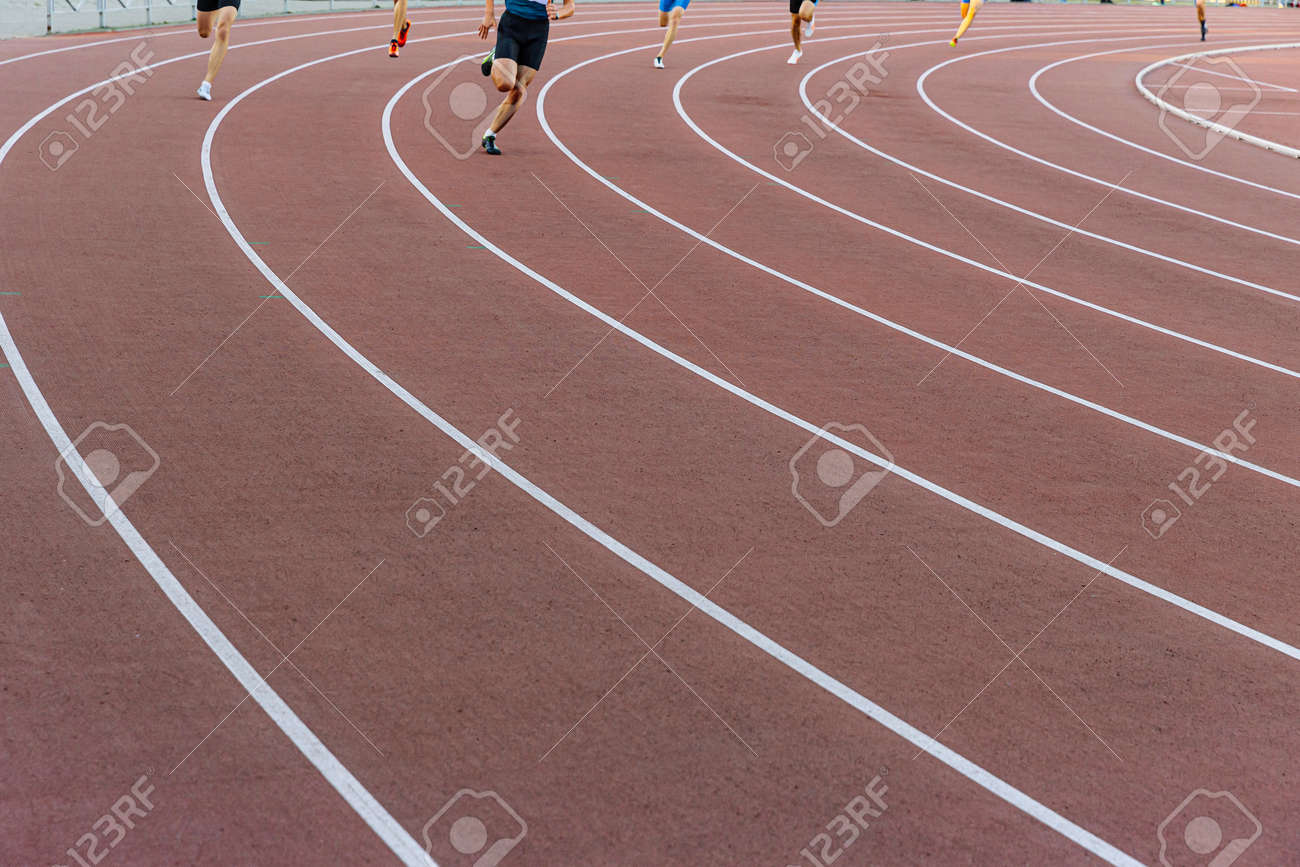legs male runners athletes run on track race - 172547535