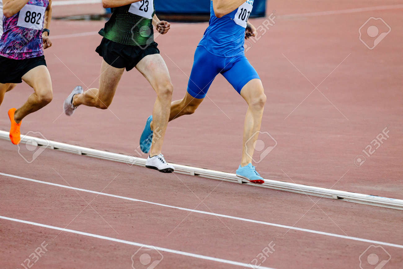 group male runners run middle distance race at stadium - 172597588