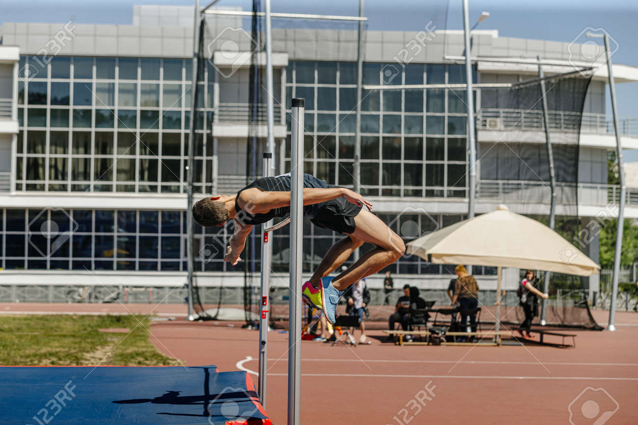 high jump male athlete successful attempt at competition - 172855758
