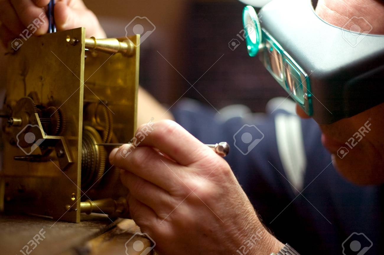 London Ontario, Canada - April 4, 2012.  Working at the same desk that his father did, Tom Buchenthal repairs the movement of a clock. Stock Photo - 13073027