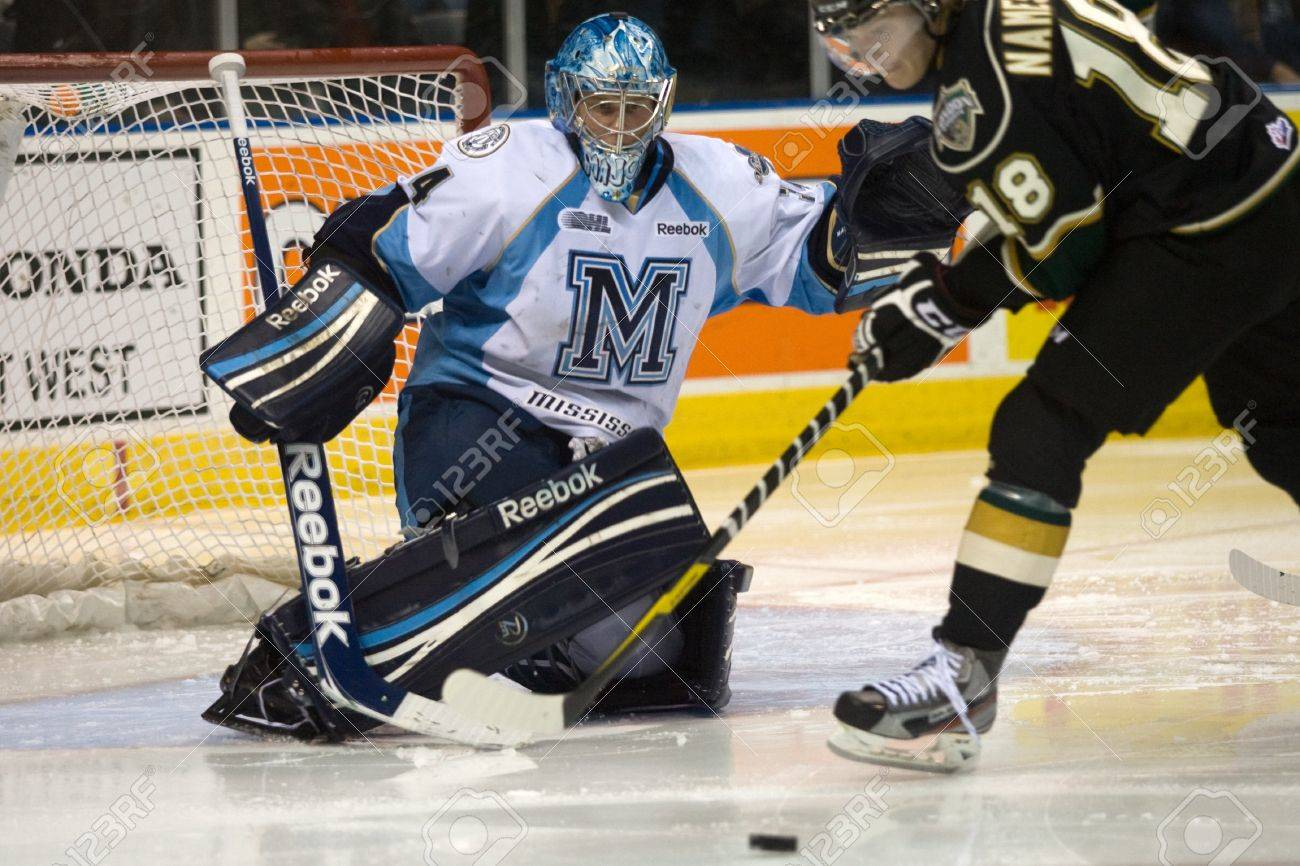 London Ontario, Canada - February 4, 2012. Majors goalie Brandon Maxwell prepares to for a shot from Vladislav Namestnikov (18) of the Knights in a Ontario Hockey League game between the London Knights and the Mississauga St. Michaels Majors. London won t Stock Photo - 13140564