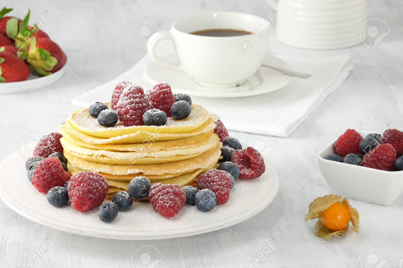 Tasty Breakfast With Pankaes With Fresh Berries And A Cup Of Stock Photo Picture And Royalty Free Image Image 93325110