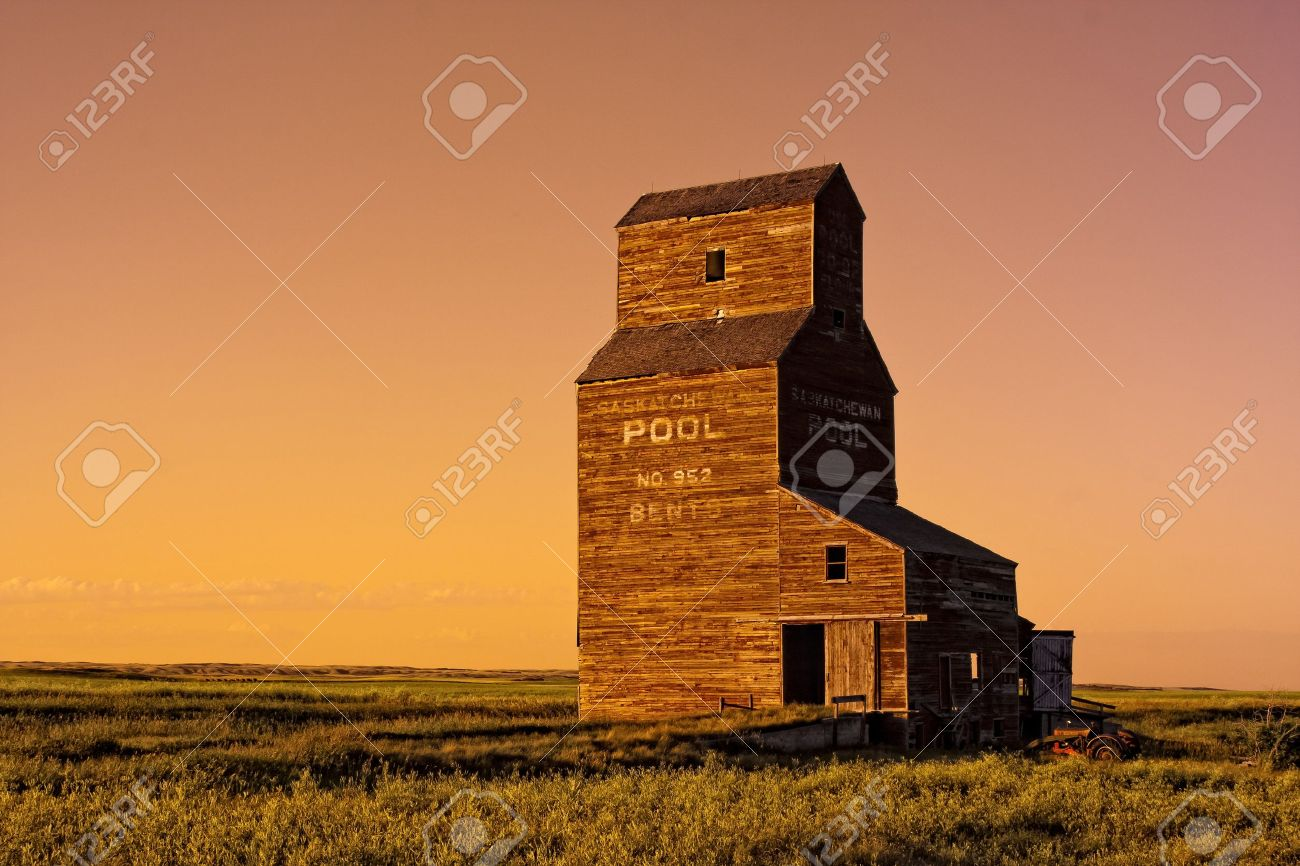 Cow on green pasture with red barn with grain silo royalty free stock - Grain Silo Abandoned Grain Elevator In The Ghost Town Of Bents On The Canadian Prairies