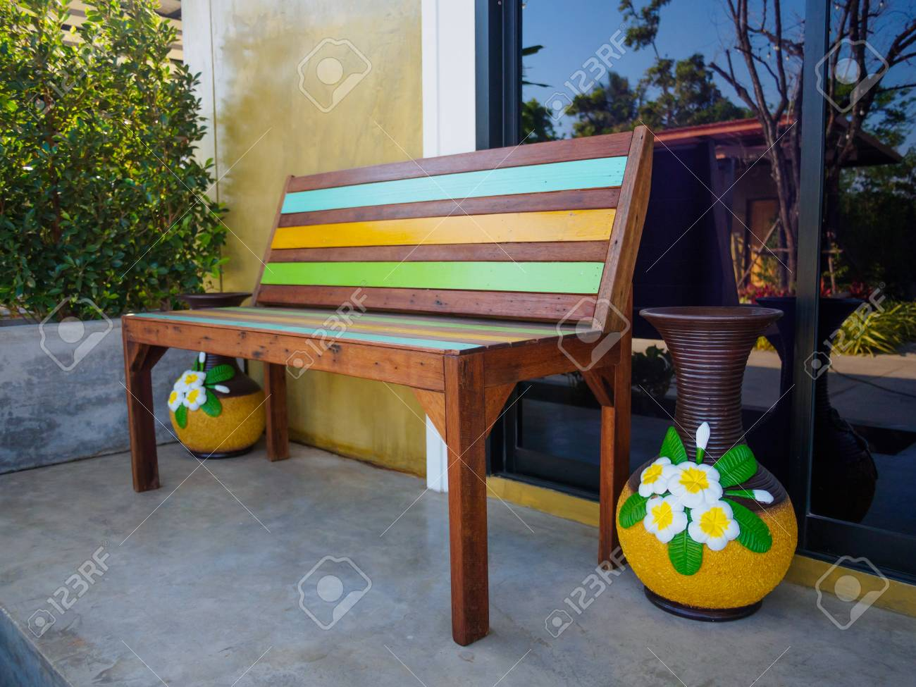 Colorful wooden patio furniture set stock photo 71609573