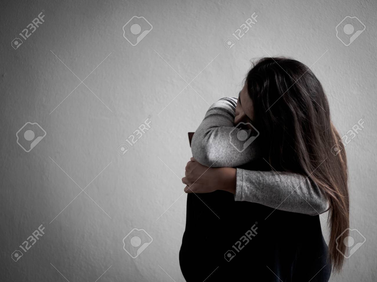 Depressed Broken Hearted Woman Sitting Alone In Dark Room At Stock Photo Picture And Royalty Free Image Image 95805088