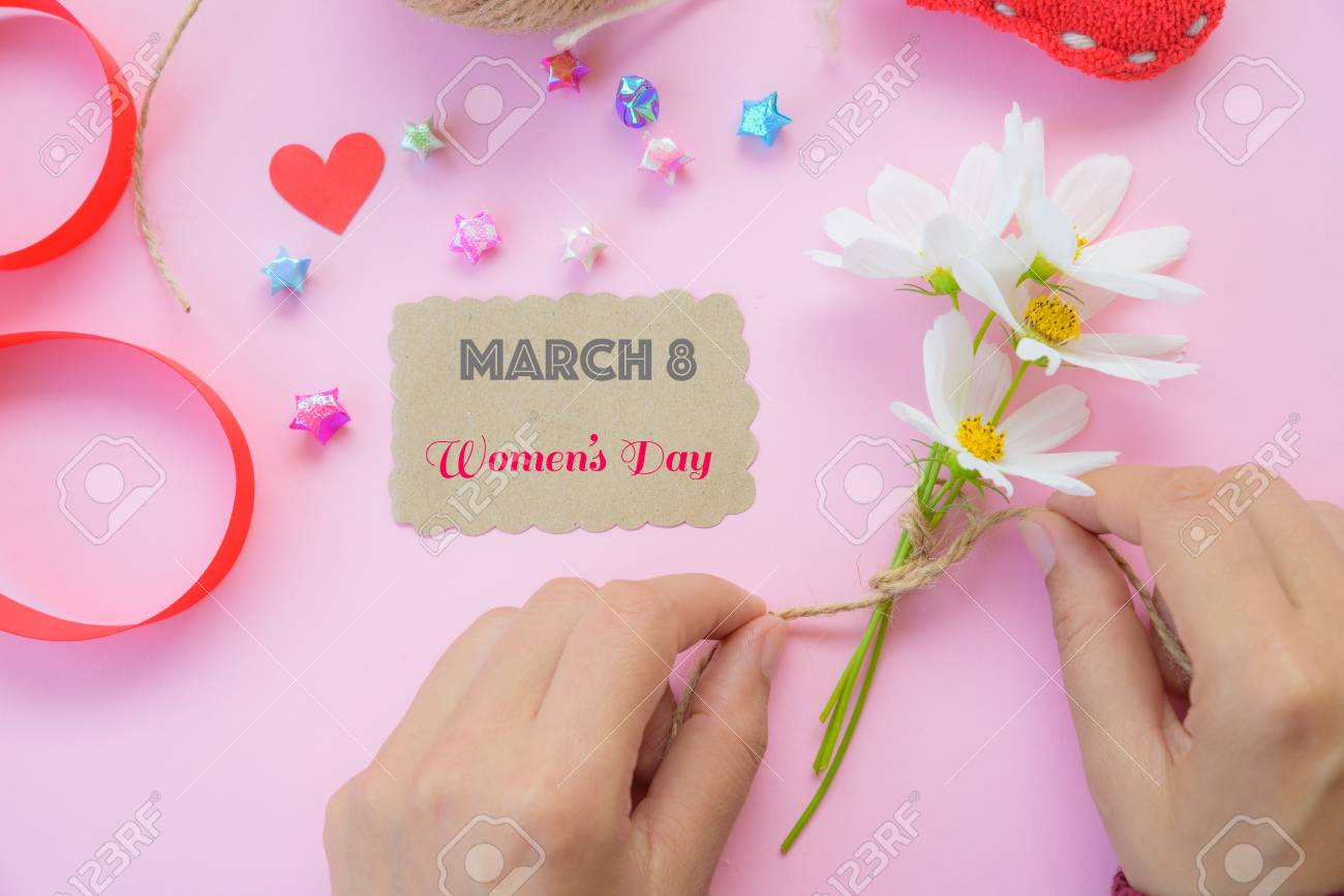 Woman Hand Holding Black Pen And Writing Happy International Womens