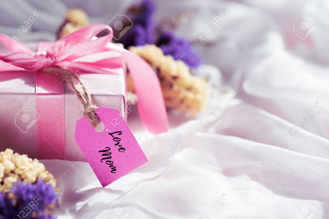 Happy Mothers Day Concept Gift Box With Purple Flower Paper