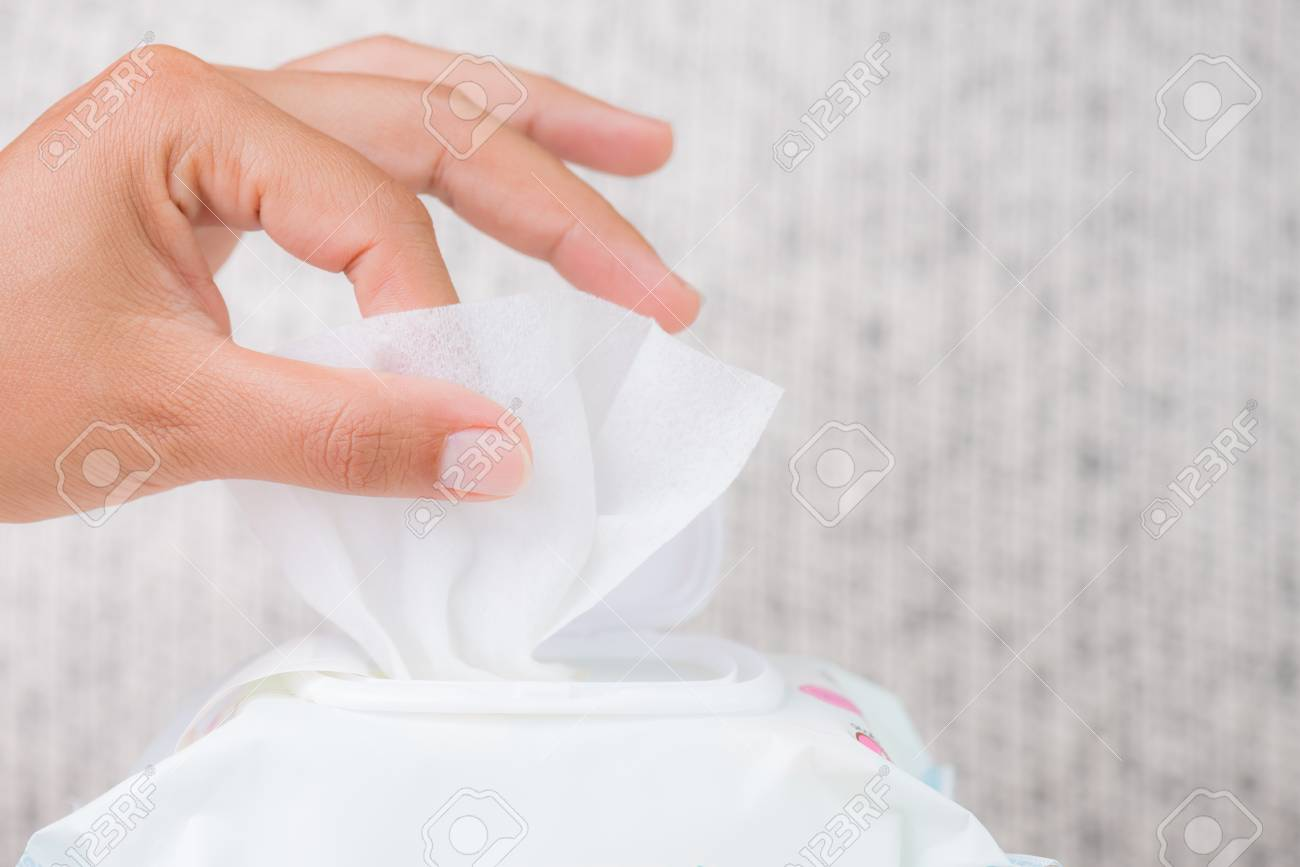 Closeup woman hand holding wet wipes from package. healthcare, people and medicine concept. - 106248790