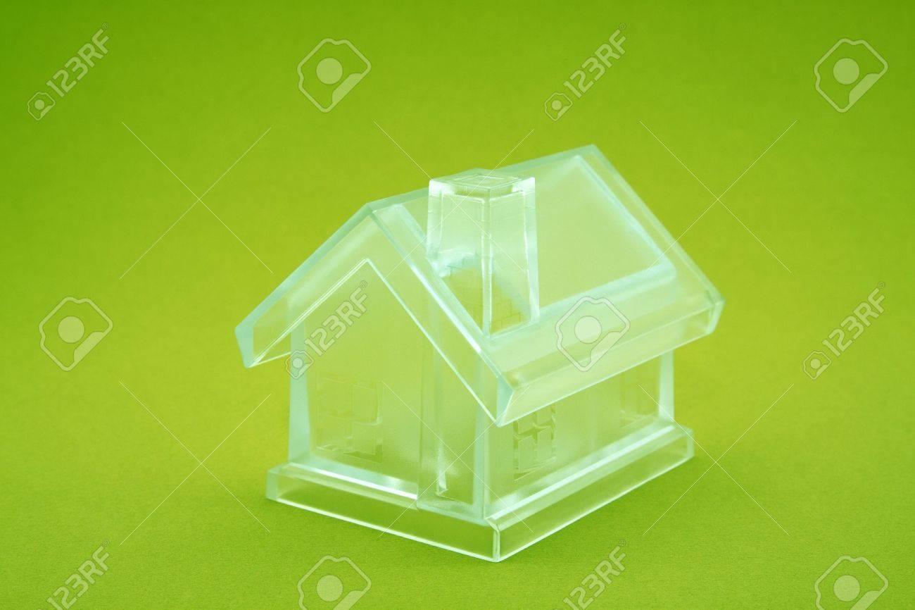 Crystal house on green background Stock Photo - 4991330
