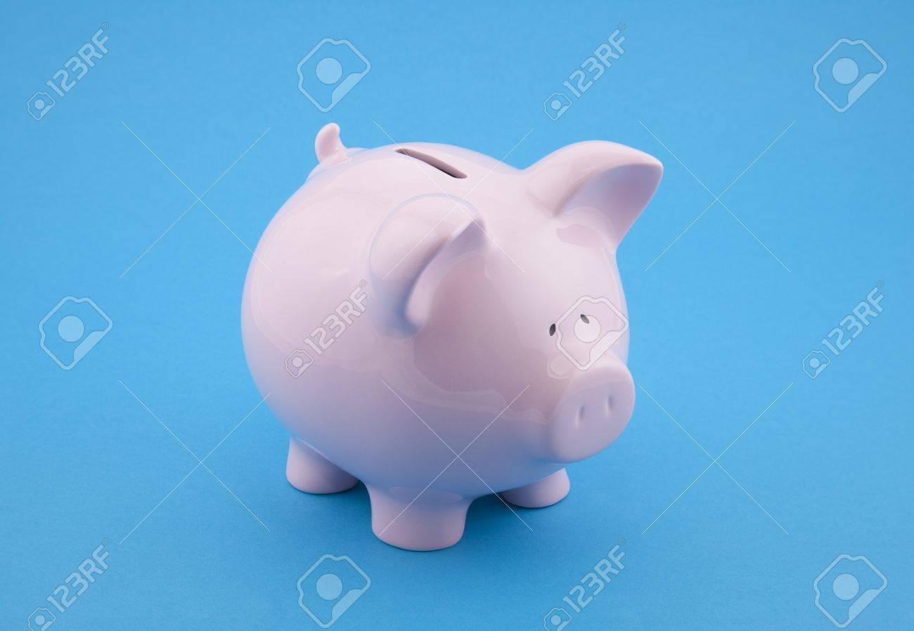 Piggy bank on blue background Stock Photo - 16259545