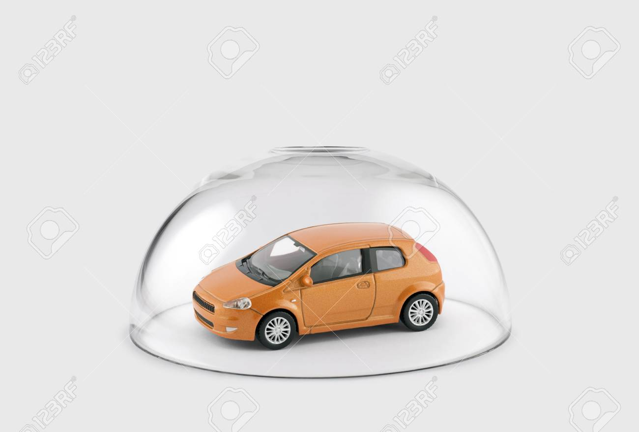 Orange car protected under a glass dome - 102134400