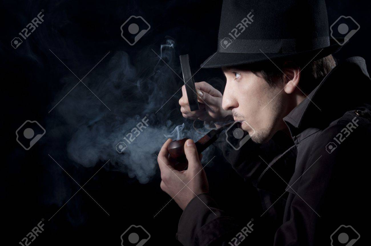Private detective searching for information, isolated on a black background Stock Photo - 8655005