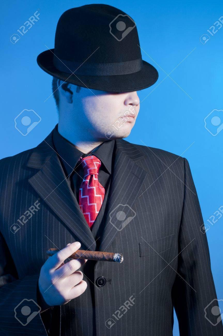 elegant gangster dressed in a black suit Stock Photo - 8649478