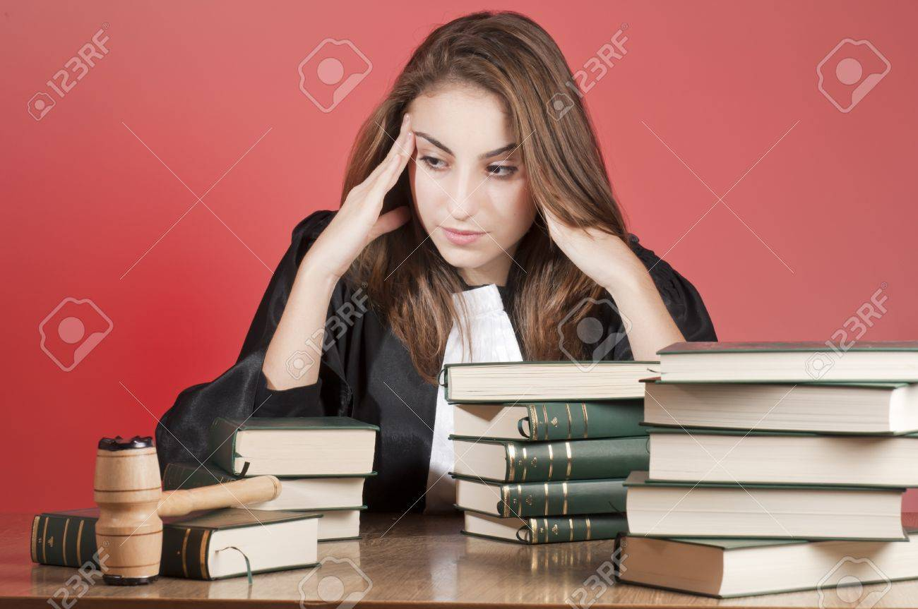 Concentrated young law school student surrounded by statute books Stock Photo - 9041646