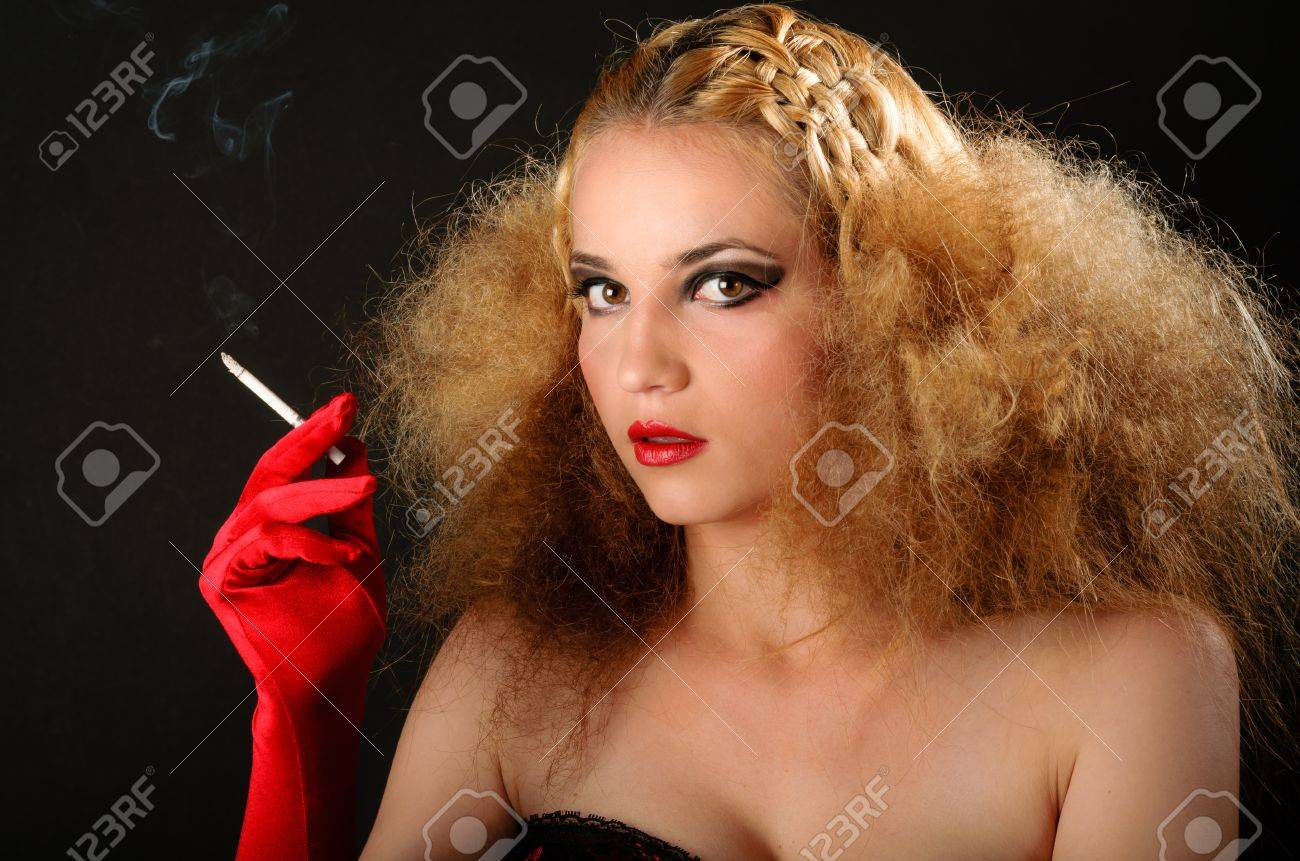 http://previews.123rf.com/images/squidmediaro/squidmediaro1212/squidmediaro121200199/16829484-Blonde-woman-with-creative-hairstyle-smoking-a-cigarette-Stock-Photo.jpg