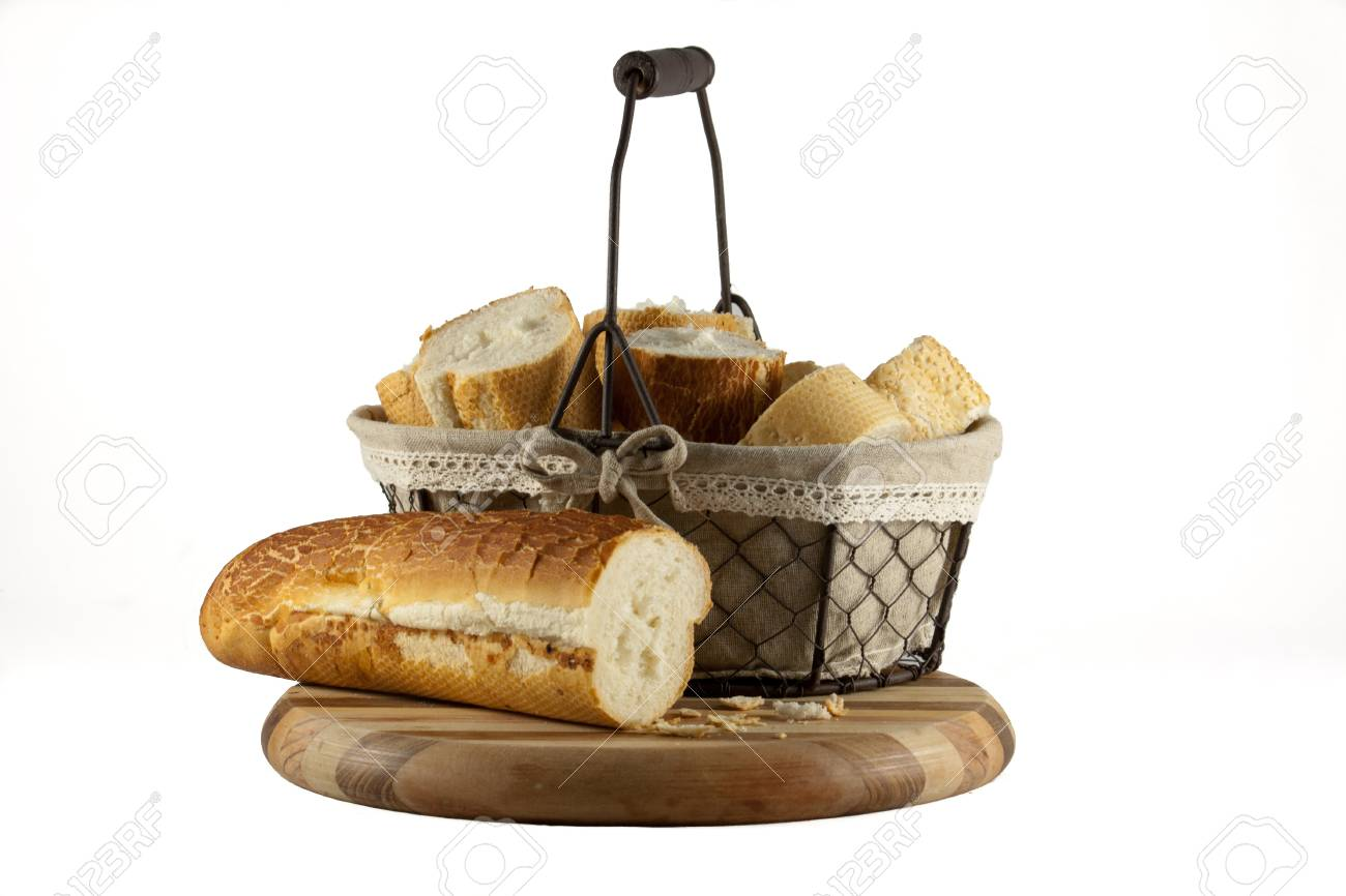 Basket of fresh bread rolls on chopping board isolated on white Stock Photo - 14642382