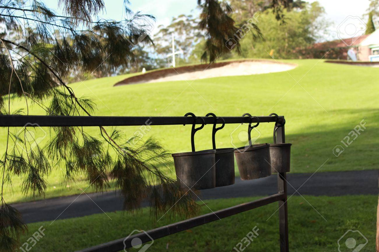 Golf sand buckets hanging next to green with bunker Stock Photo - 18223918