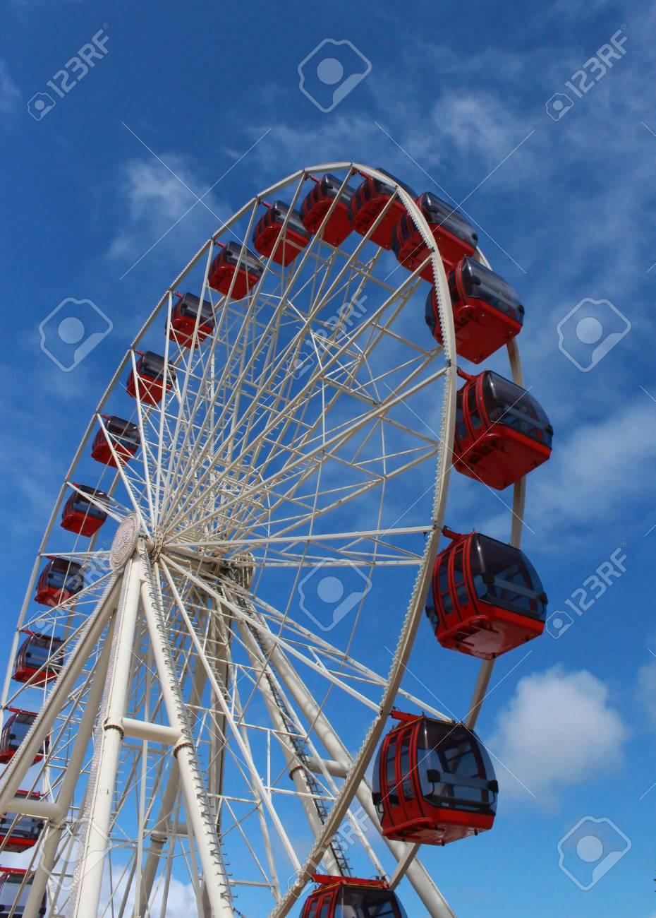 Ferris wheel at amusement park against blue sky Stock Photo - 23320241