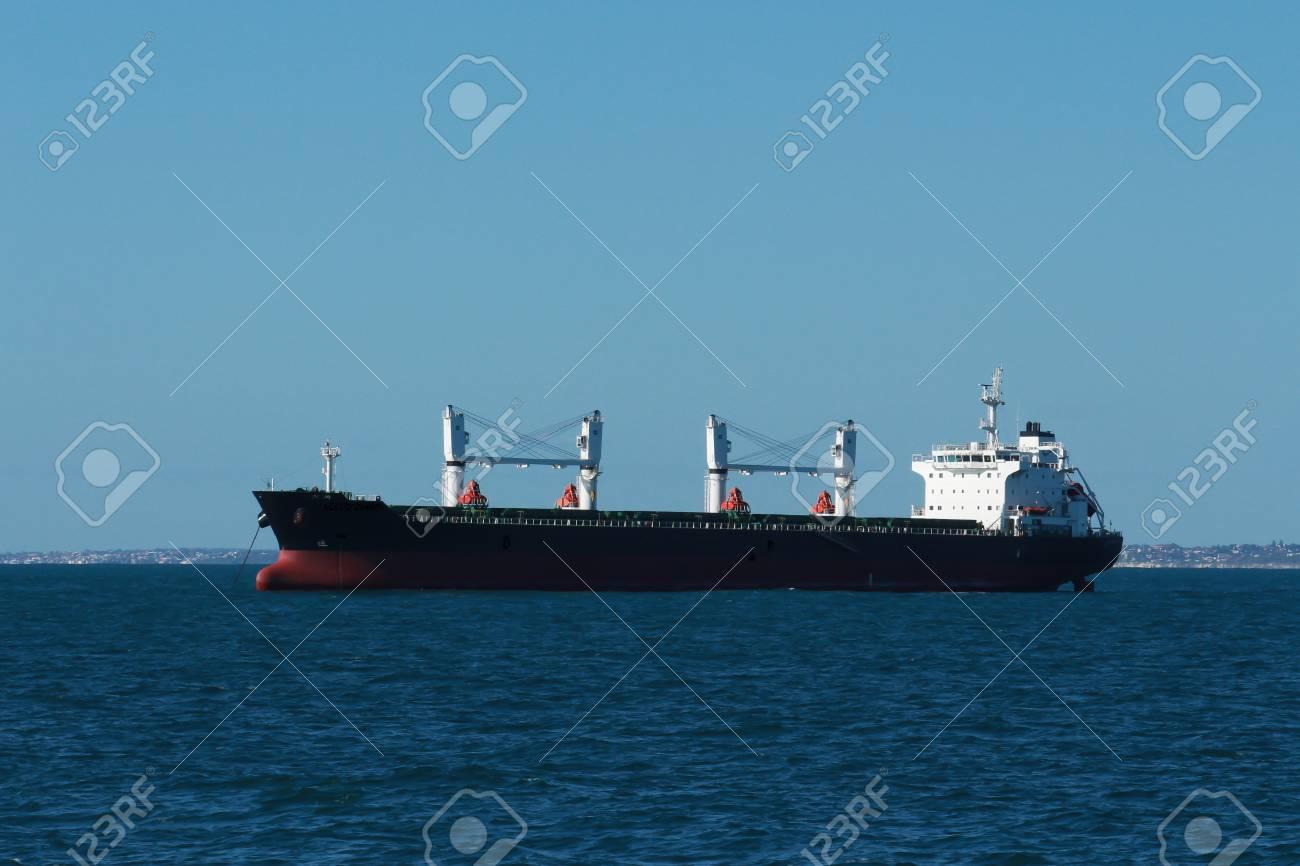 Cargo freight ship on calm water Stock Photo - 23320264
