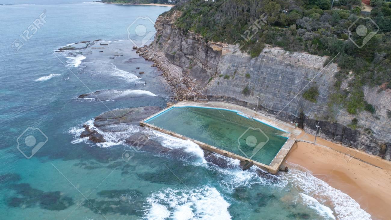 Aerial view of ocean seaside swimming pool at Bilgola Beach,..