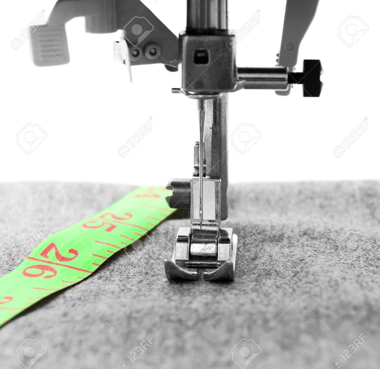 The sewing machine and measuring roulette Stock Photo - 13809944