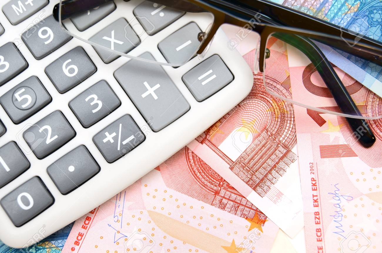 Glasses and the calculator for euro. Stock Photo - 17237104