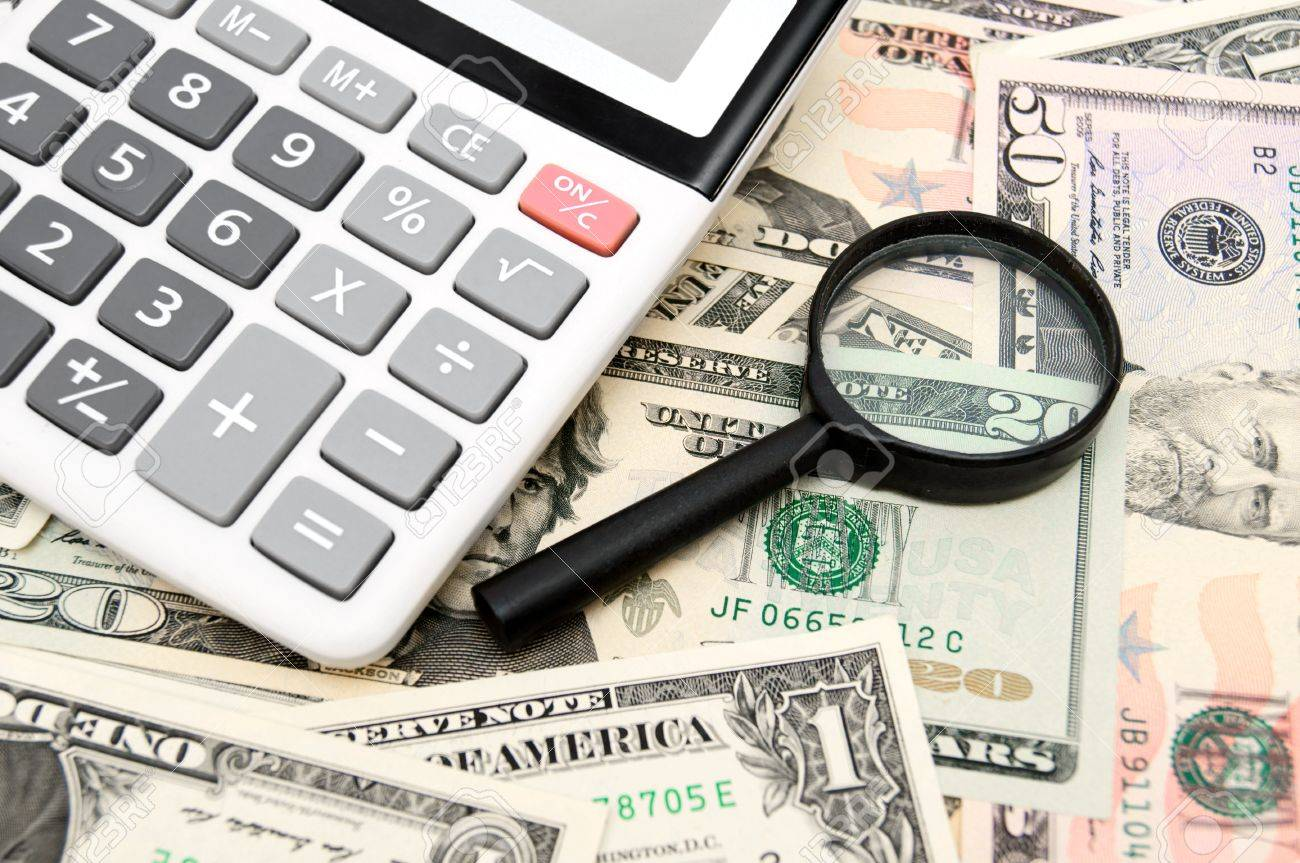 Calculator and magnifier on money. Stock Photo - 17237058