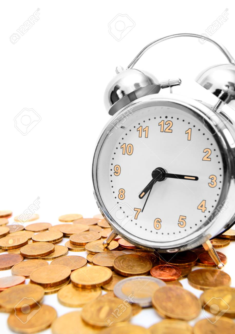 Alarm clock on gold coins Stock Photo - 17213493