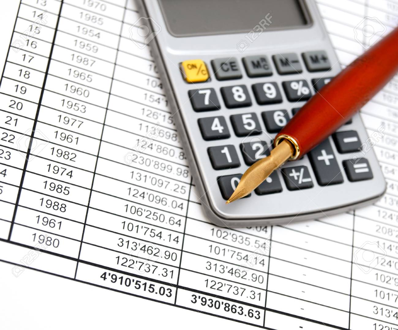 Calculator and pen on documents Stock Photo - 17213487