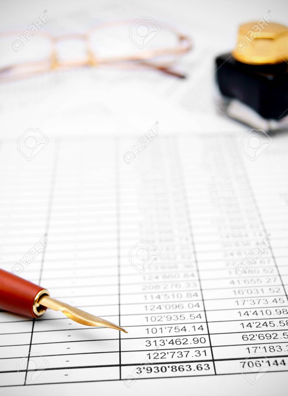 Pen, ink and glasses on the documents Stock Photo - 17217500
