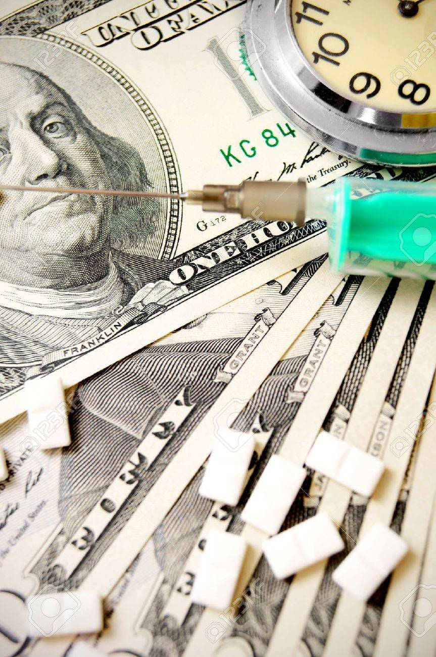 Hours, tablets and a syringe on dollars Stock Photo - 17218014