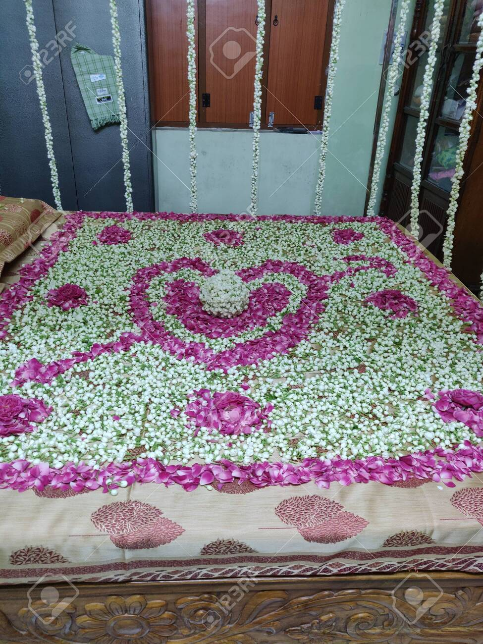 First Night Romantic Bedroom With Flowers Of Rose And Jasmine Stock Photo Picture And Royalty Free Image Image 122328053