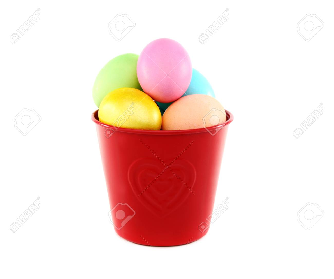 Easter eggs in red bucket on a white background. Stock Photo - 12774524