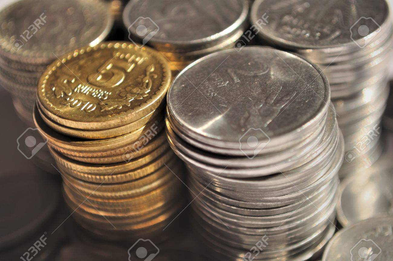 Stack of Indian currency coins of denomination Rs.5, Rs.2 and Re.1 Stock Photo - 9577595